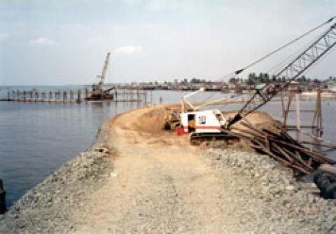 Initial Access Road by quarry spalls for the Reclamation of Area B. The access road includes one of the approaches of the Navotas Cut-Off Channel Bridge