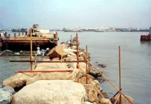 Placing of armor rock bulkhead at reclamation Area A